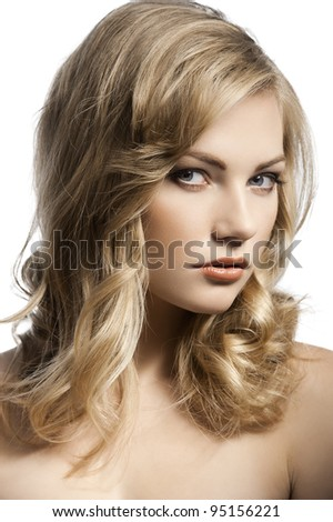 close up beauty portrait of a young and alluring blond girl with hair style over white