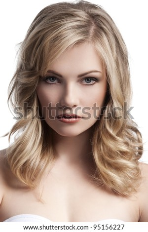 close up beauty portrait of a young and cute blond girl with hair style over white