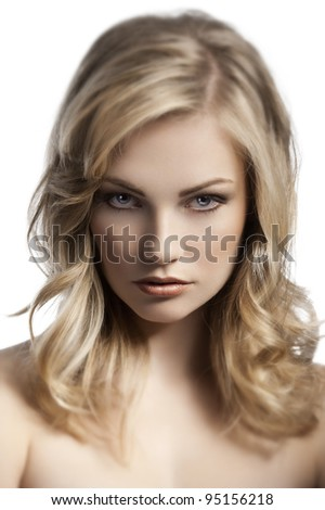 close up beauty portrait of a young and cute blond lady with hair style over white