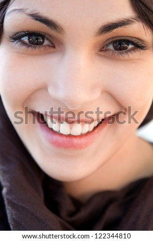 Close up beauty portrait of an attractive hispanic woman wearing red lipstick and biting her lips. - stock photo