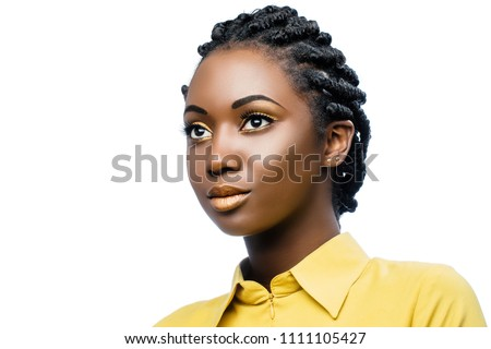 Close up beauty portrait of attractive young african woman wearing professional make up.Girl with stylish braided hairstyle isolated on white background.