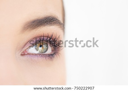 Close up beauty portrait of beautiful young woman eye wearing make up with perfect flawless skin, looking up, seeing. Eyes, pupil, lashes, brows. Healthy sight and vision. Cosmetics youth, lifestyle.