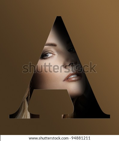 close up beauty portrait of young pretty woman behind a color brown letter A