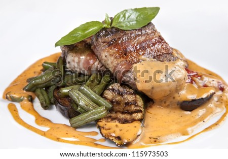 Close-up - beef steak grilled with asparagus and grilled vegetables with sauce - isolated