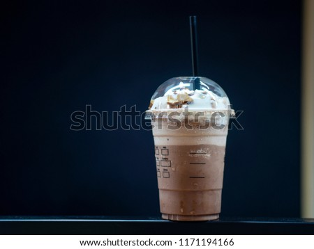 Close up beverage of chocolate smoothie for Summer put on the table with black background in cafe.  #1171194166