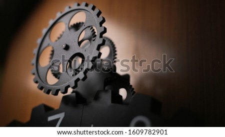 close-up big gear. black gear mechanism.