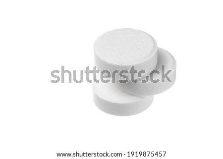 Close-up big round pills isolated on white background. Big white tablets of round shape on white background. Zdjęcia stock ©