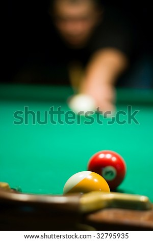 Close up billiard ball on the billiard table and unfocused player on the background