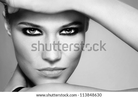 Close-up black and white portrait of beautiful stylish blonde girl with trendy make-up