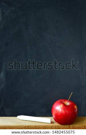 Close up black chalk board in chalk stains chalk board and red apple, selective focus, copyspace