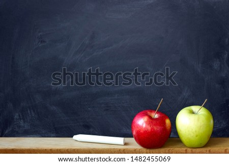 Close up black chalk board in chalk stains chalk board and two apples red and green, selective focus, copyspace