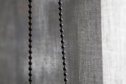 Close Up black roller blinds or curtains on the glass wall