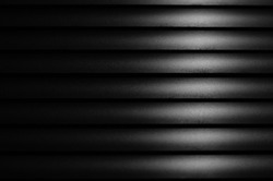 Close up Black window blinds with light, Dark background