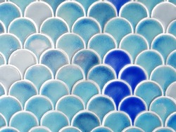 close up blue fish scales wall tile with random tone of blue, cyan and white color. mermaid and under water concept background.