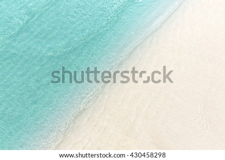Close up blue sea water waves on white sand beach in Thailand, Beautiful blue sea beach with white sand, Beautiful blue ocean beach close up shot, Clean beach with blue sea in Thailand