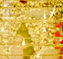 Close up blurred fairy lights and golden bokeh