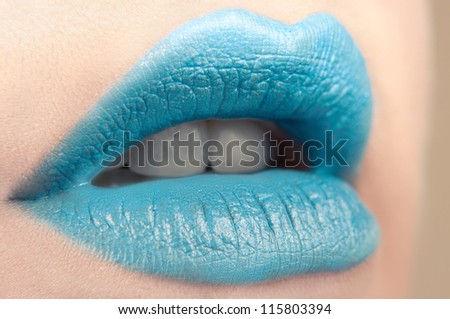 close-up body part portrait of beautiful woman's lips bright blue make up - stock photo