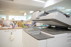 Close-up bottom panel of the photocopier or Xerox printer machine is office work tool equipment in copy room for scanning document and printout a paper.