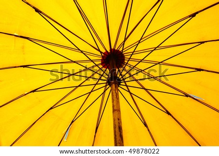 Close up bottom view of a yellow beach umbrella