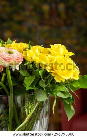 Close up Bouquet of Fresh Cut Beautiful Flowers, on Transparent Glass Vase with Water, on Top of the Table.