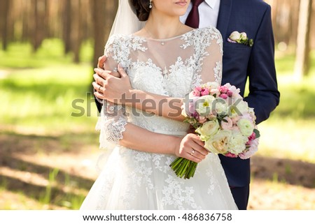 Close-up bride and groom with peony bouquet #486836758