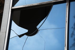 Close up broken glass buildings