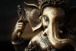 Close up Bronze Ganesha statue  and Golden texture ganesh is hindu god god of Success