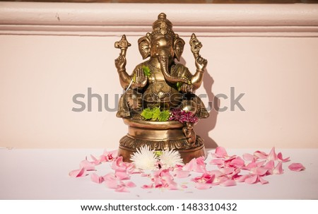 Close up Bronze Ganesha statue and Golden texture Ganesh is hindu God God of Success #1483310432
