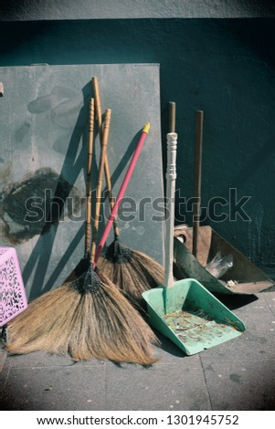 Close-up broom, powder scoop, vintage style, pastel background #1301945752