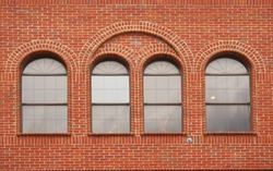 Close-up Building Detail Brick Wall With Arched Windows