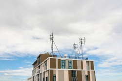 Close up building tower which has antenna on the rooftop