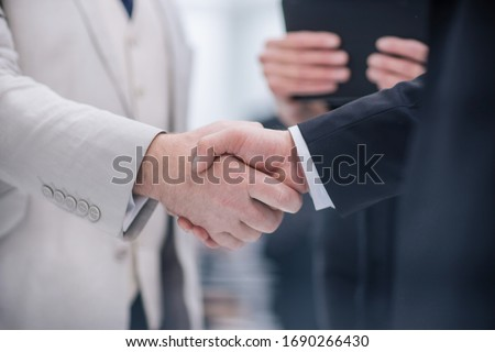 close up. business handshake on the background of the office