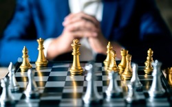 close up business man formal suit hand think and planing to win chess board game business stratey organize and management ideas concept