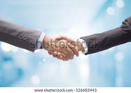close up business man handshake together after meeting about agreement contract and accept in financial cooperative,successful of synergy people shake hand concept