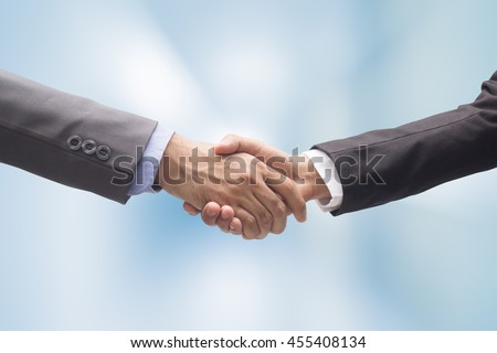 close up business man handshake together on blur background,successful concept