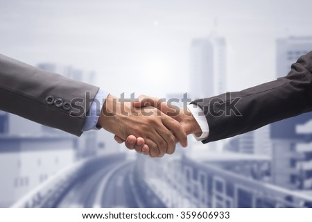 close up business man handshake together on cityscape background:agreement ,accept,approve financial cooperative concept.improve/development of world international network.trust,goal,team,hand,shake