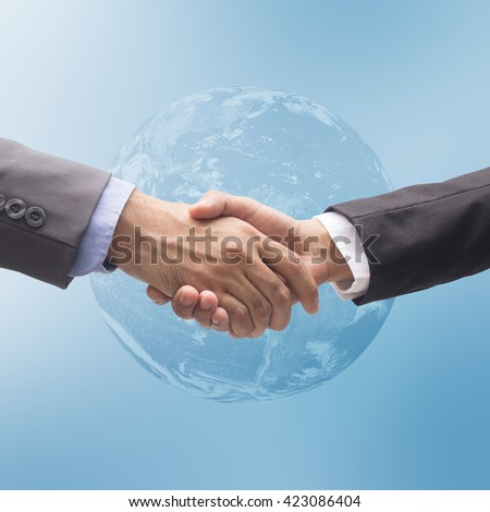 close up business man in suit clothes are handshake on world map background for world economic concept