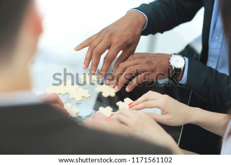 close up. business team assembling puzzle pieces. Stock photo ©