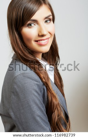 Close up business woman face portrait isolated on white background. Smiling female model office suit dressed.