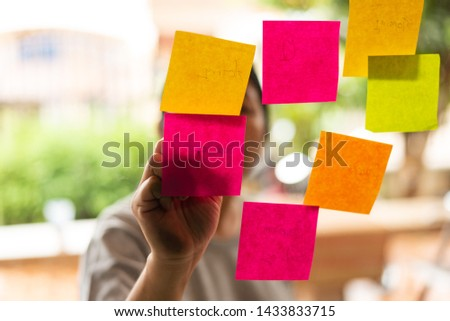 Close up business woman hand writing note sticky for brainstorm and share idea strategy workshop business.Brainstorming concept. #1433833715