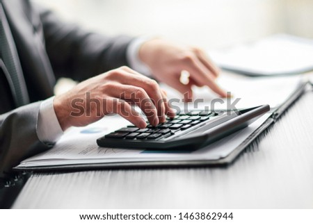 close up. businessman can use the calculator to calculate profit