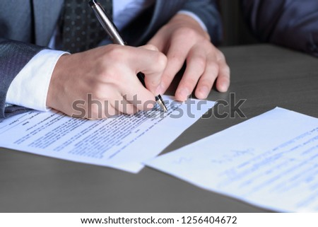 close up.businessman filling out the contract form.