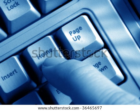 close up businessman fingers typing on a keyboard