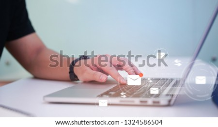 close up businessman hand touchscreen on keyboard laptop devices for sending e-mail listing to partner or opening mail from customer at desk in office , virtual interface technology concept #1324586504