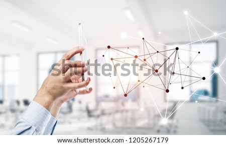 Close up businessman hand using smart phone and connection lines as concept. 3d rendering #1205267179