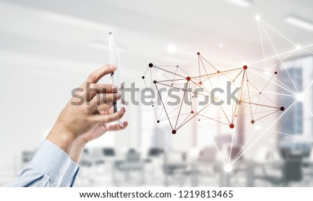 Close up businessman hand using smart phone and connection lines as concept. 3d rendering #1219813465