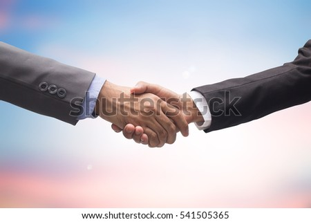 close up businessman handshake together after meeting and successful of acquisition for assurance and agreement in business synergy concept