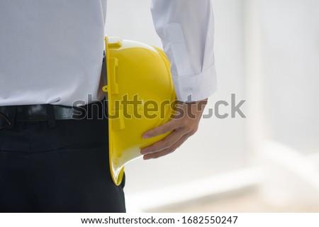 Close up Businessman holding yellow hard hat builder construction estate Stock foto ©