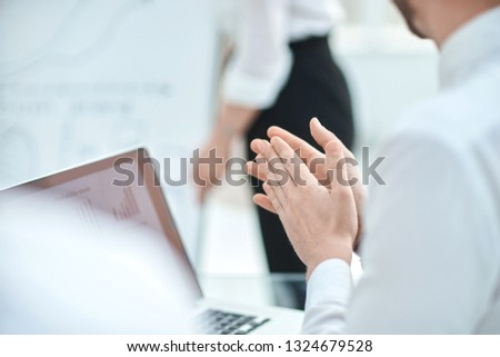 close up. businessman looking at laptop screen and applauding #1324679528