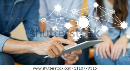 close up businessman  manager point on tablet and meeting with secretary woman with futuristic network connecting line communication for future technology concept
